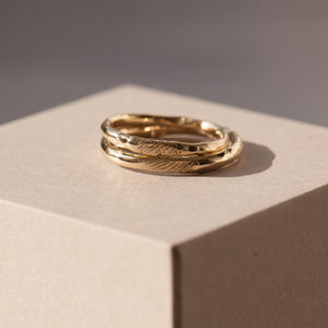Raw finger-prints wedding rings