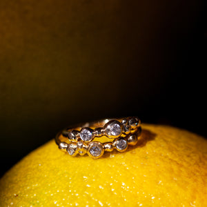 Raw bubbley gold ring with 3 diamond