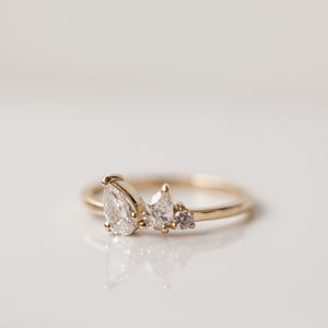 Two drop tri-stone gold ring