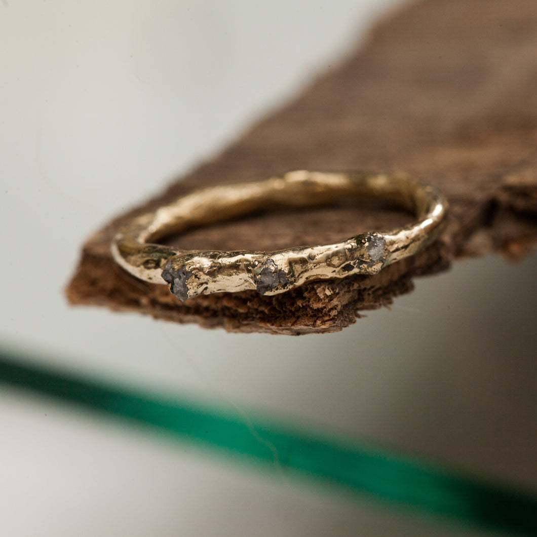 Raw gold ring with 3 rough diamonds