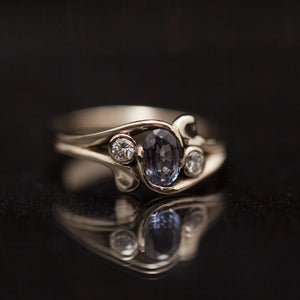 Unique tri-stone engagement ring