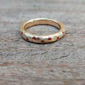 Scattered ruby gold ring