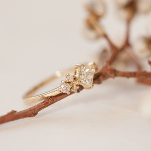 Square cluster uneven diamond ring