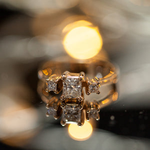 Square tri-stone engagement ring