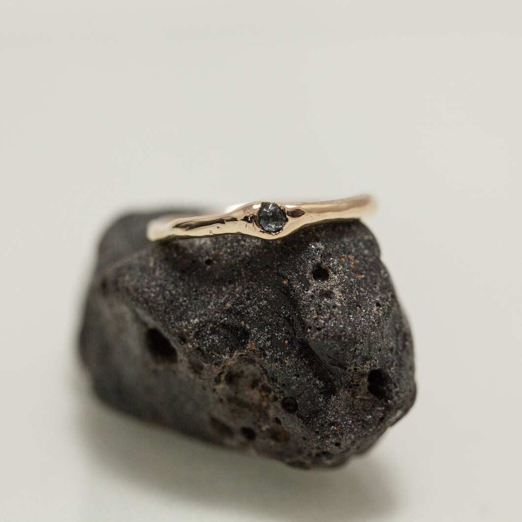 Buried blue sapphire ring