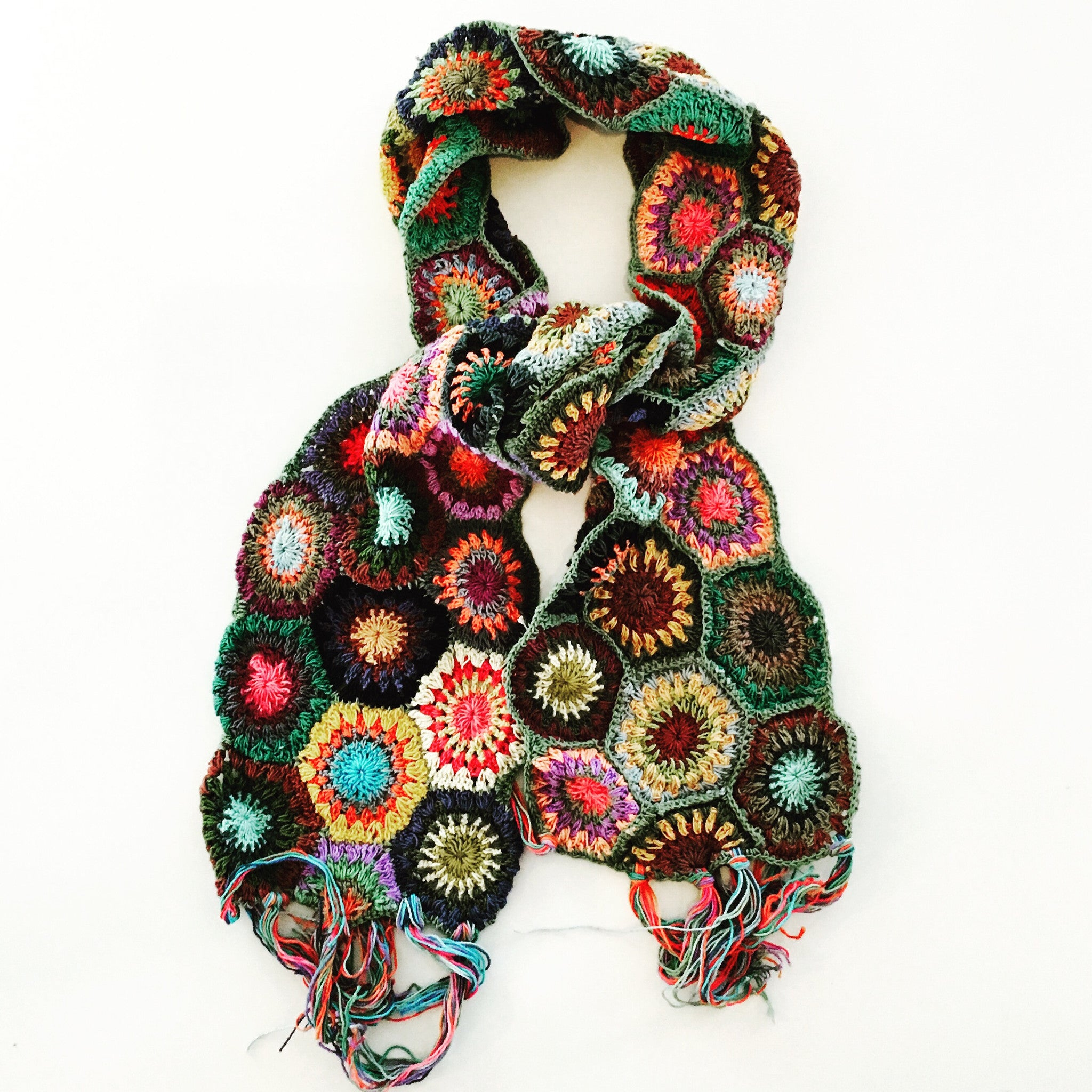 Outerwear,hand crocheted, 100% cotton, multi colored scarf. Made in Nepal. Portion of proceeds supports GlobalDentalRelief.org.  Size: 65 inches long plus 6 inch fringe