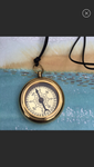 Jewelry, brass compass on leather