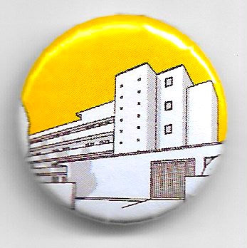 Lapel badge Isokon yellow