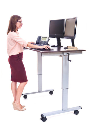 Feel the effects of sitting all day? Try a sit-stand workstation.