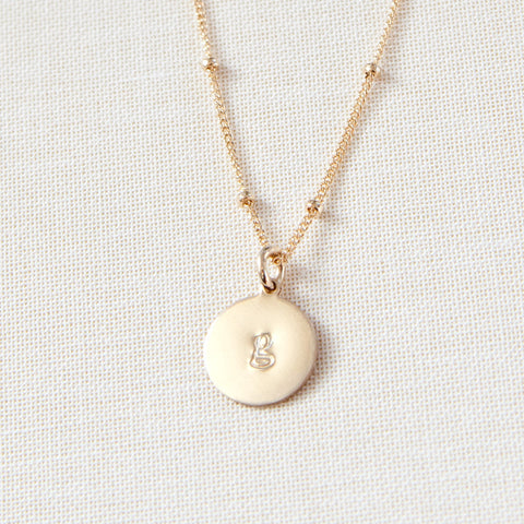 gold disc charm necklace