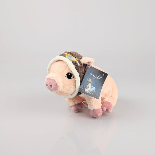 Cute, pink pig wearing aviator goggles on its head.