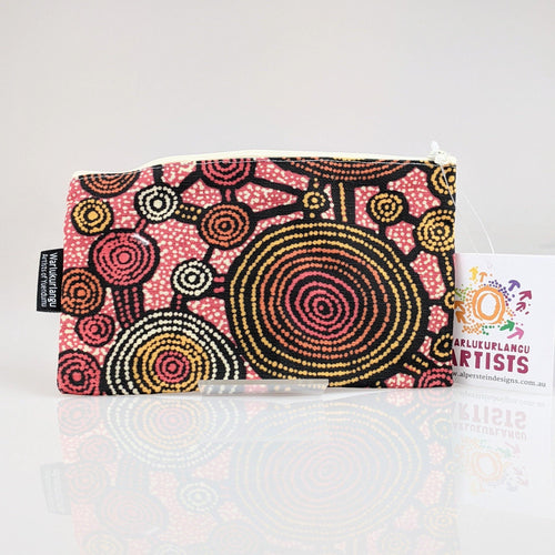 Cotton zip bag with Indigenous artwork printed on it.