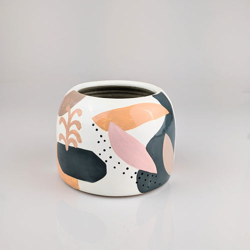 Short, wide pot with hand painted abstract modernist shapes.