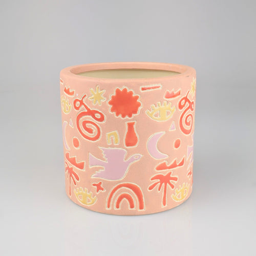 Large pink planter with colourful icons