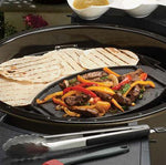Broil King Keg Cast Iron Griddle cooking food in BBQ