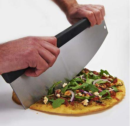 Broil King Mezzaluna Pizza Cutter cutting pizza