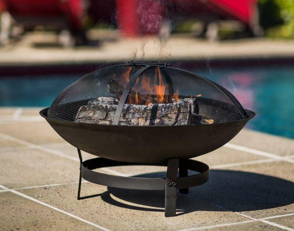 Round Fire Pit outdoors with flame