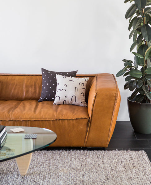 Hills + Valleys Linen Pillow on a modern sofa