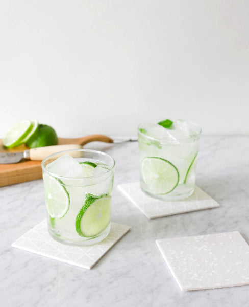 White felt coasters holding happy hour drinks - designed by Cotton & Flax