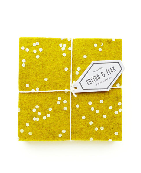 Gold confetti coasters packaged with twine and a white branded tag