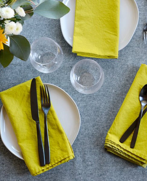 Modern dinner table set with linen napkins from Cotton & Flax