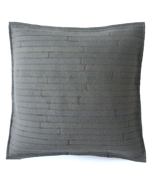 Reverse side of a grey wool felt throw pillow