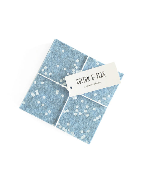 Ice blue wool felt coasters packaged with twine and a Cotton & Flax tag