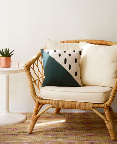 Quilted throw pillow from Cotton & Flax in a boho chair
