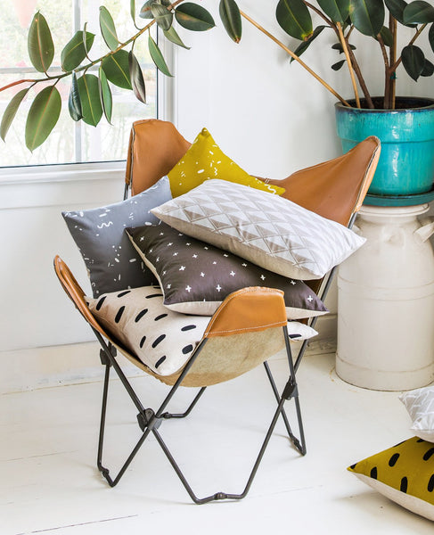 Pile of decorative throw pillows from Cotton & Flax
