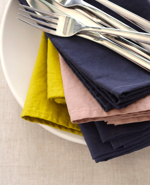 Pile of multicolor linen napkins from Cotton & Flax