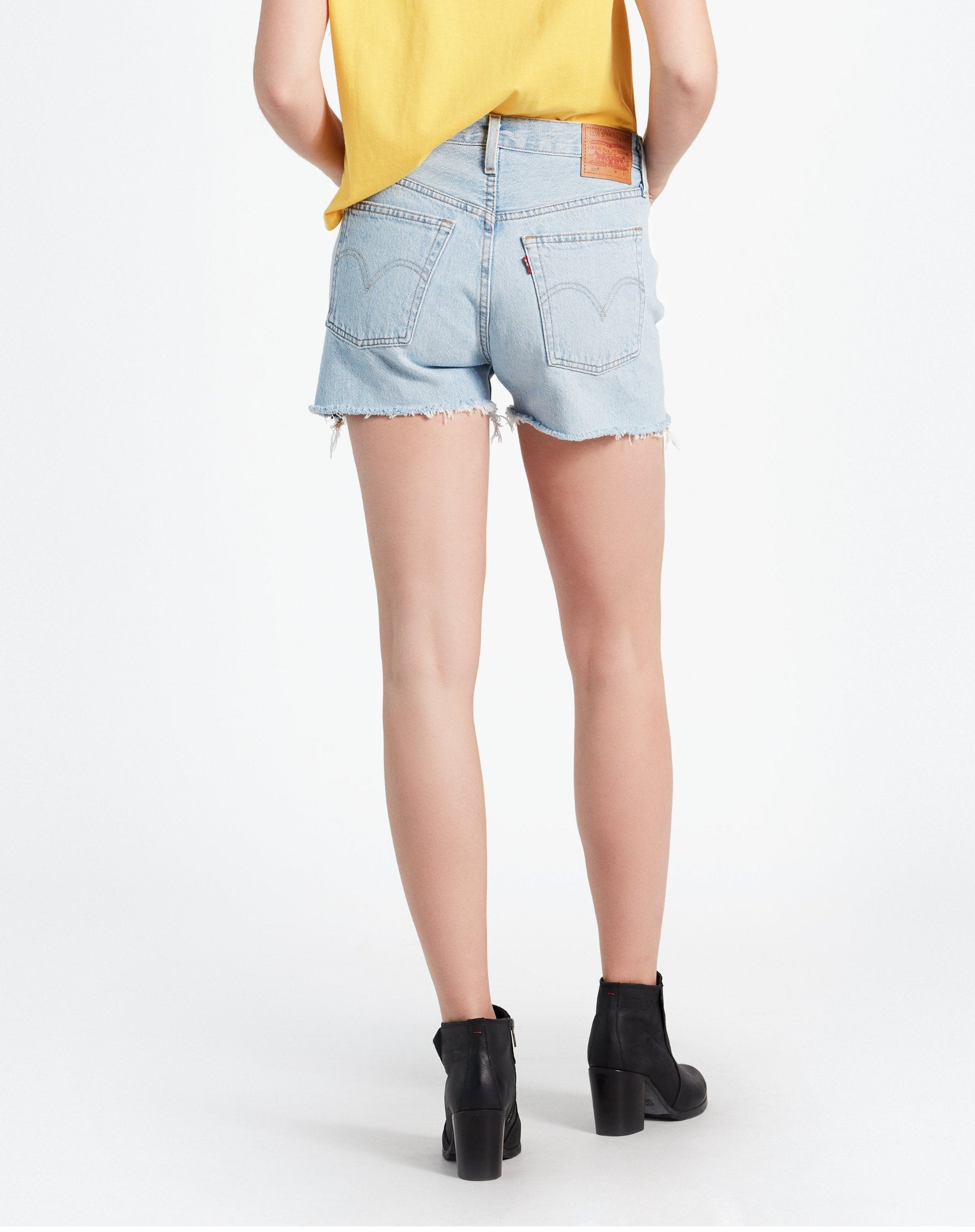 Photo of the back of the Weak in the Knees light denim shorts by Levi.