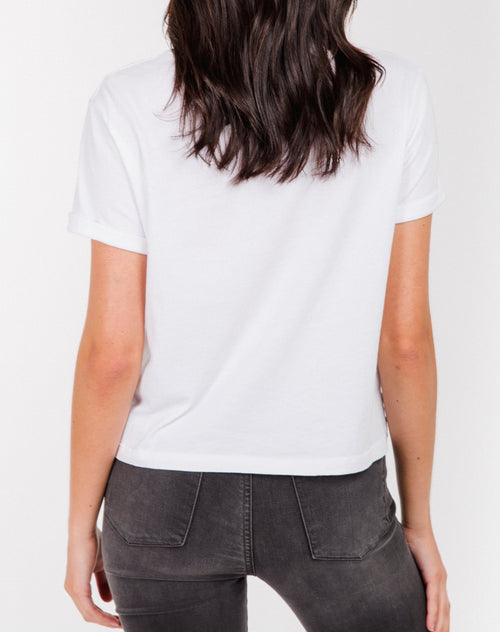 Photo of the back of the Redhead cropped tee in white by Brunette the Label.