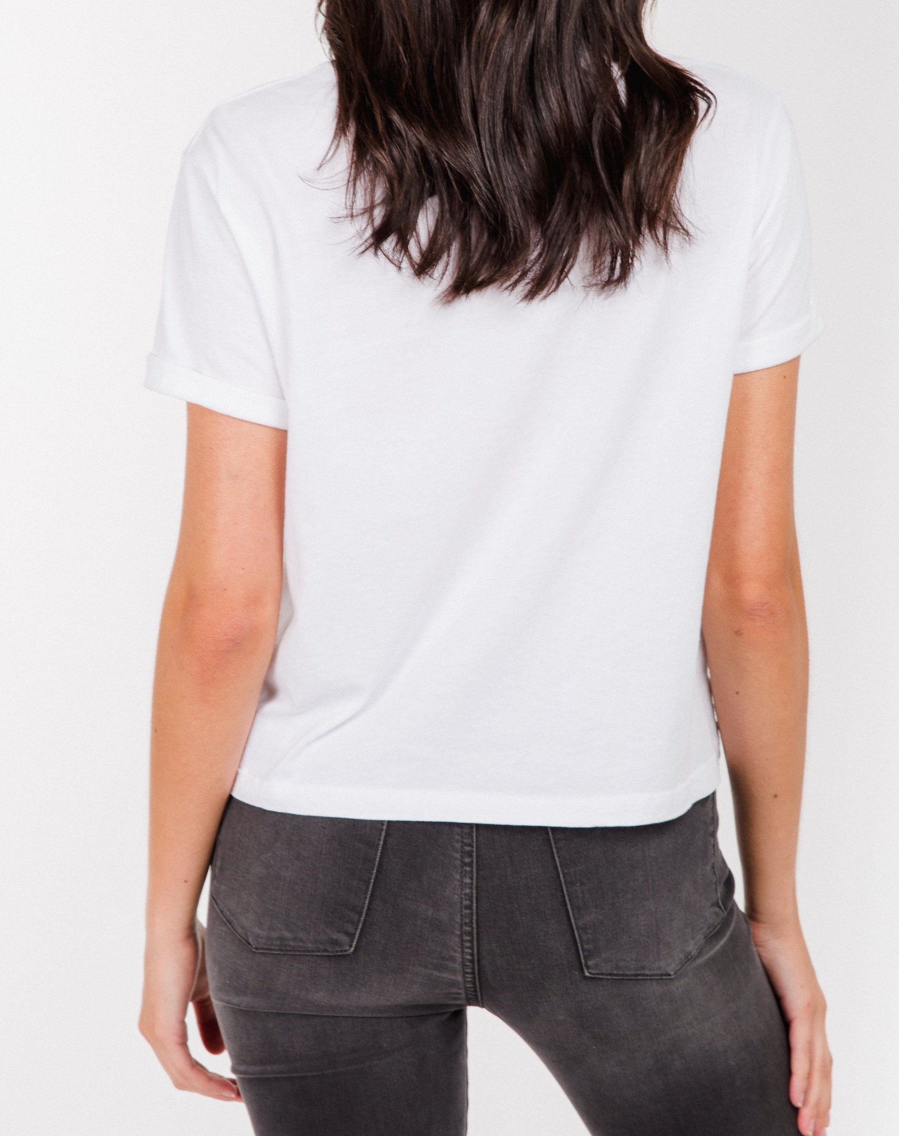 Photo of the back of the Blonde Classic creck neck tee in cropped fit in white by Brunette the Label.