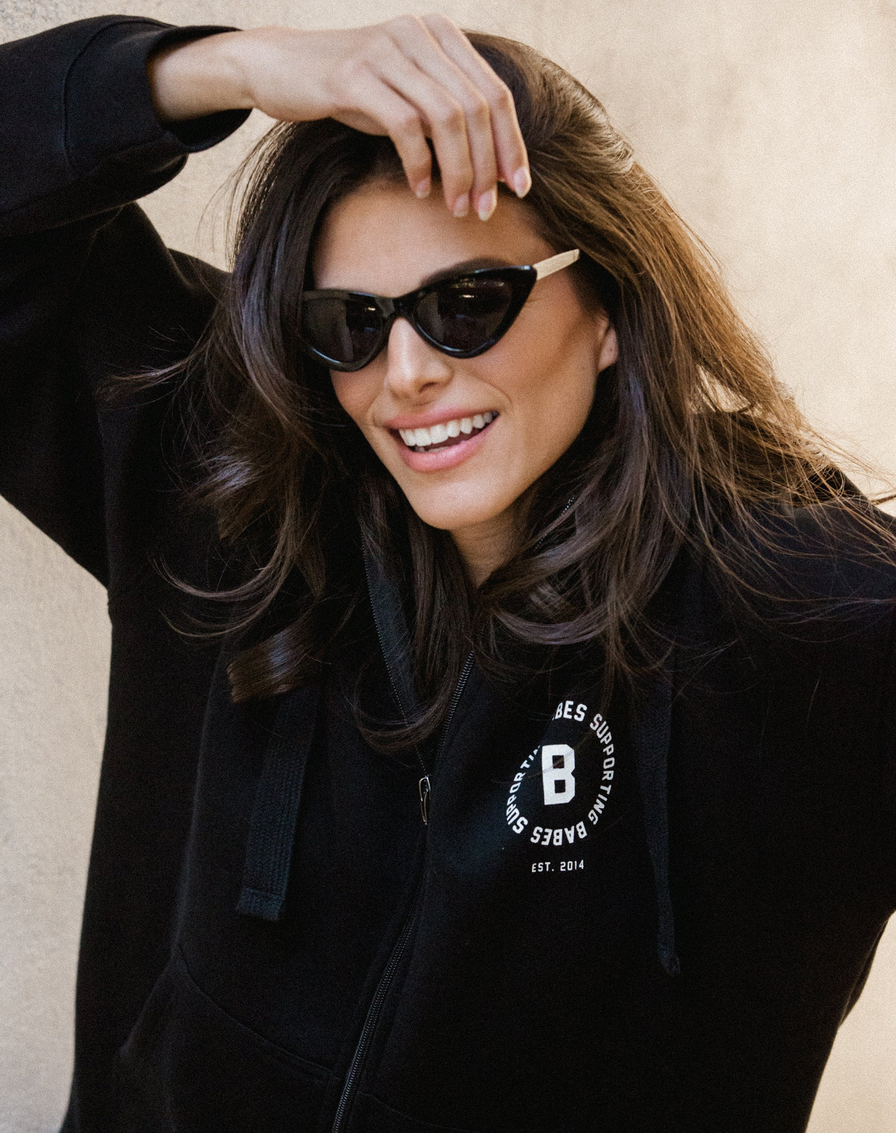 Photo 2 of the Babes Supporting Babes big sister zip up hoodie in black by Brunette the Label.