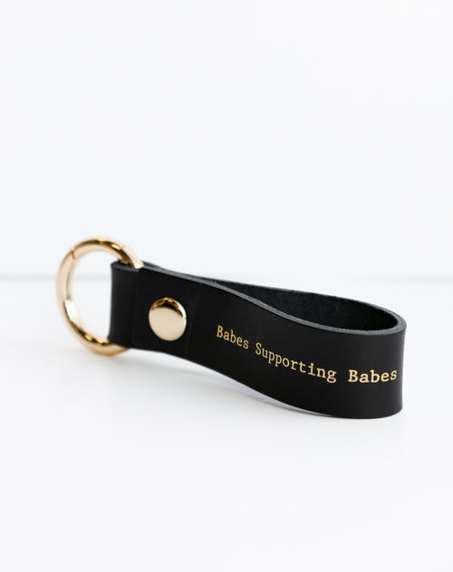 Photo of the Babes Supporting Babes Key Chain in vegan leather and hand pressed gold printing by Brunette the Label.