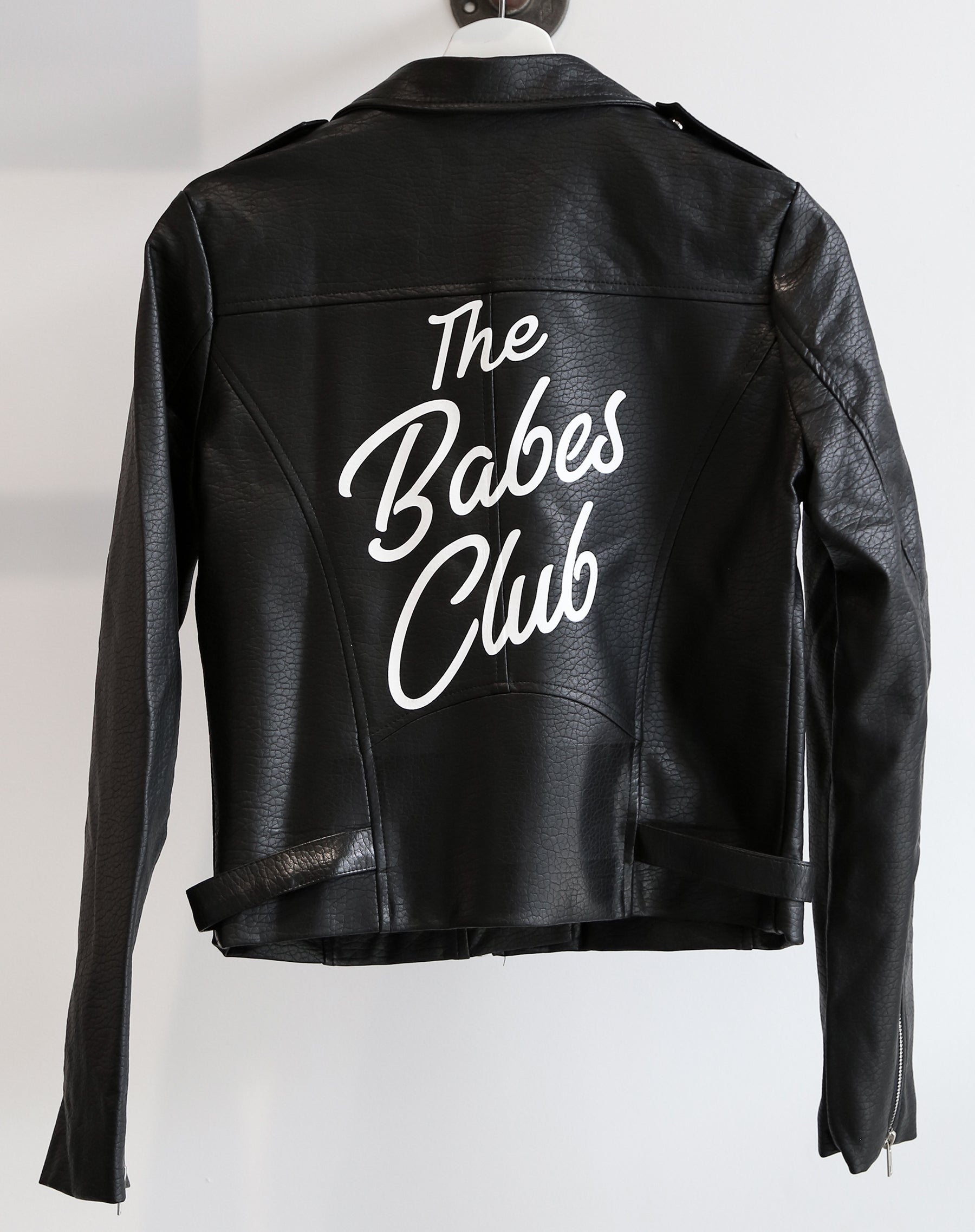 Photo of the Florence vegan leather moto jacket in black with the babes club print by Brunette the Label.