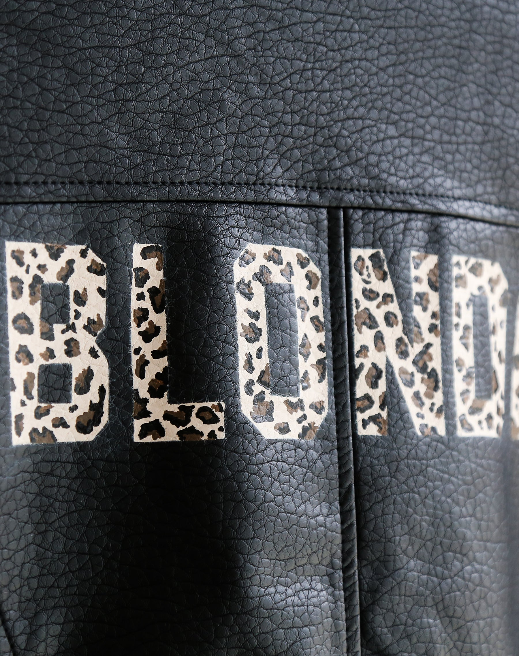 Close up photo of the Blonde Florence hand painted vegan leather moto jacket in leopard by Brunette the Label.