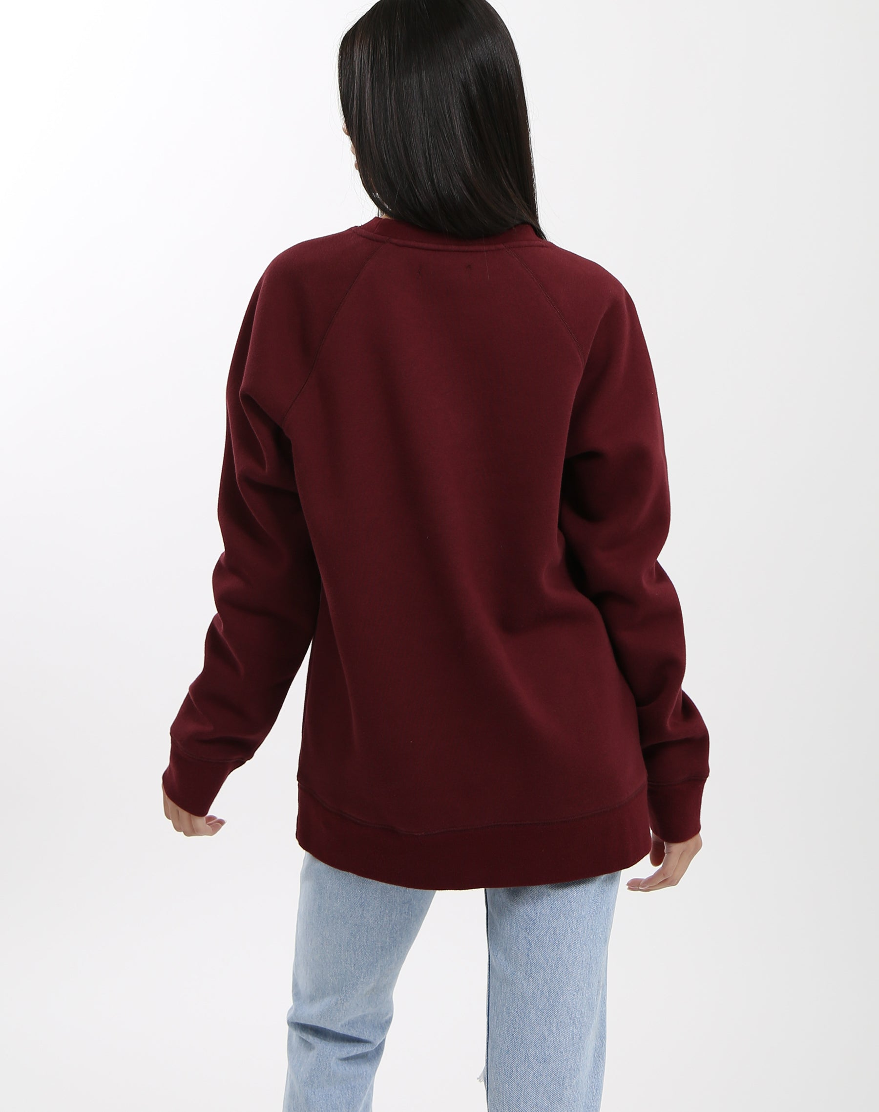 Photo of the back of the Redhead classic crew neck sweatshirt in burgundy by Brunette the Label.