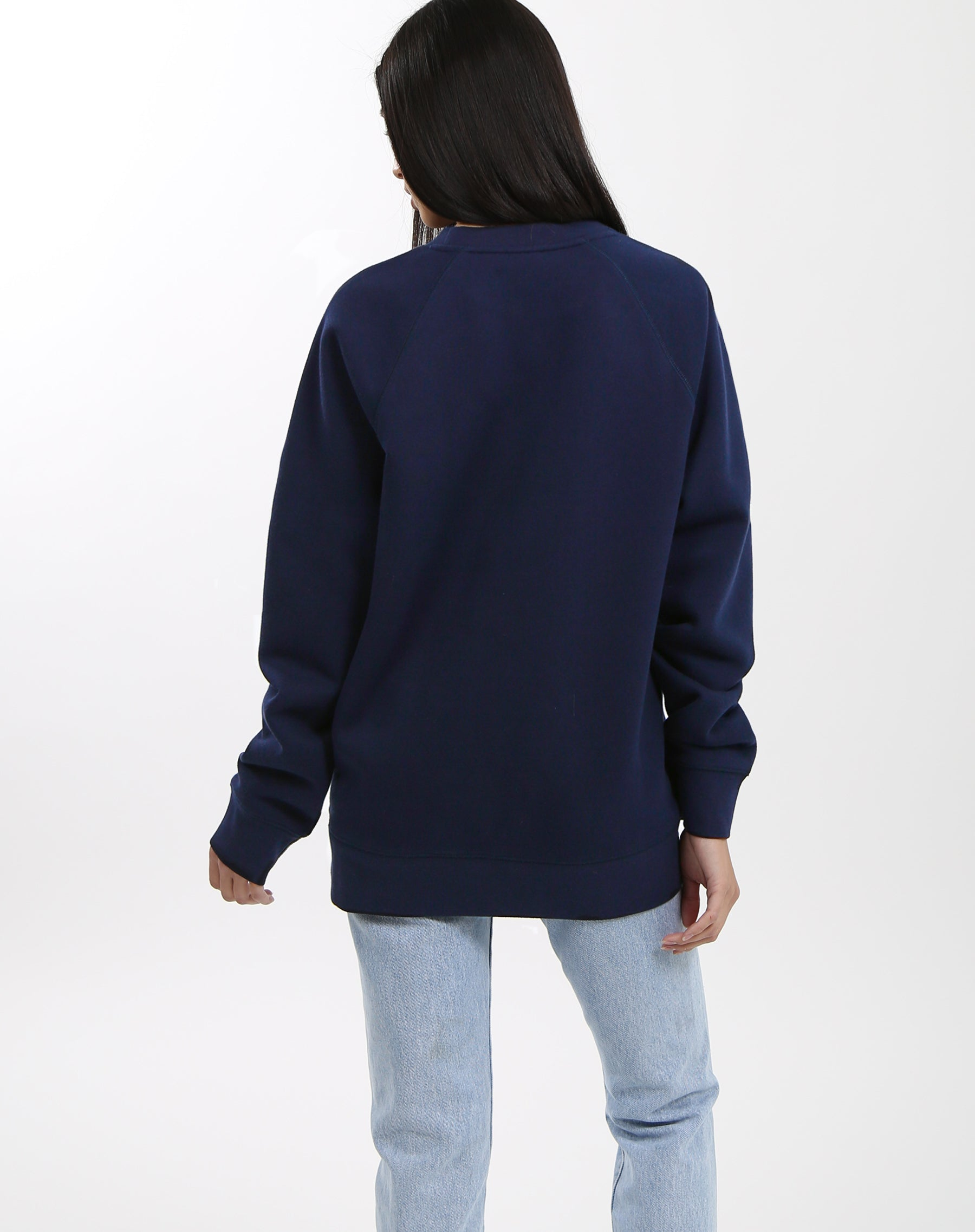 Photo of the back of the Brunette classic crew neck sweatshirt in navy by Brunette the Label.