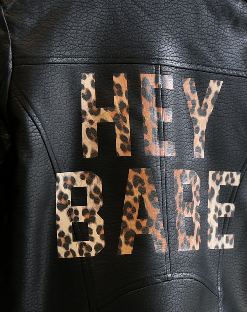 Close up photo of the Florence vegan leather moto jacket in Hey Babe Leopard print by Brunette the Label.