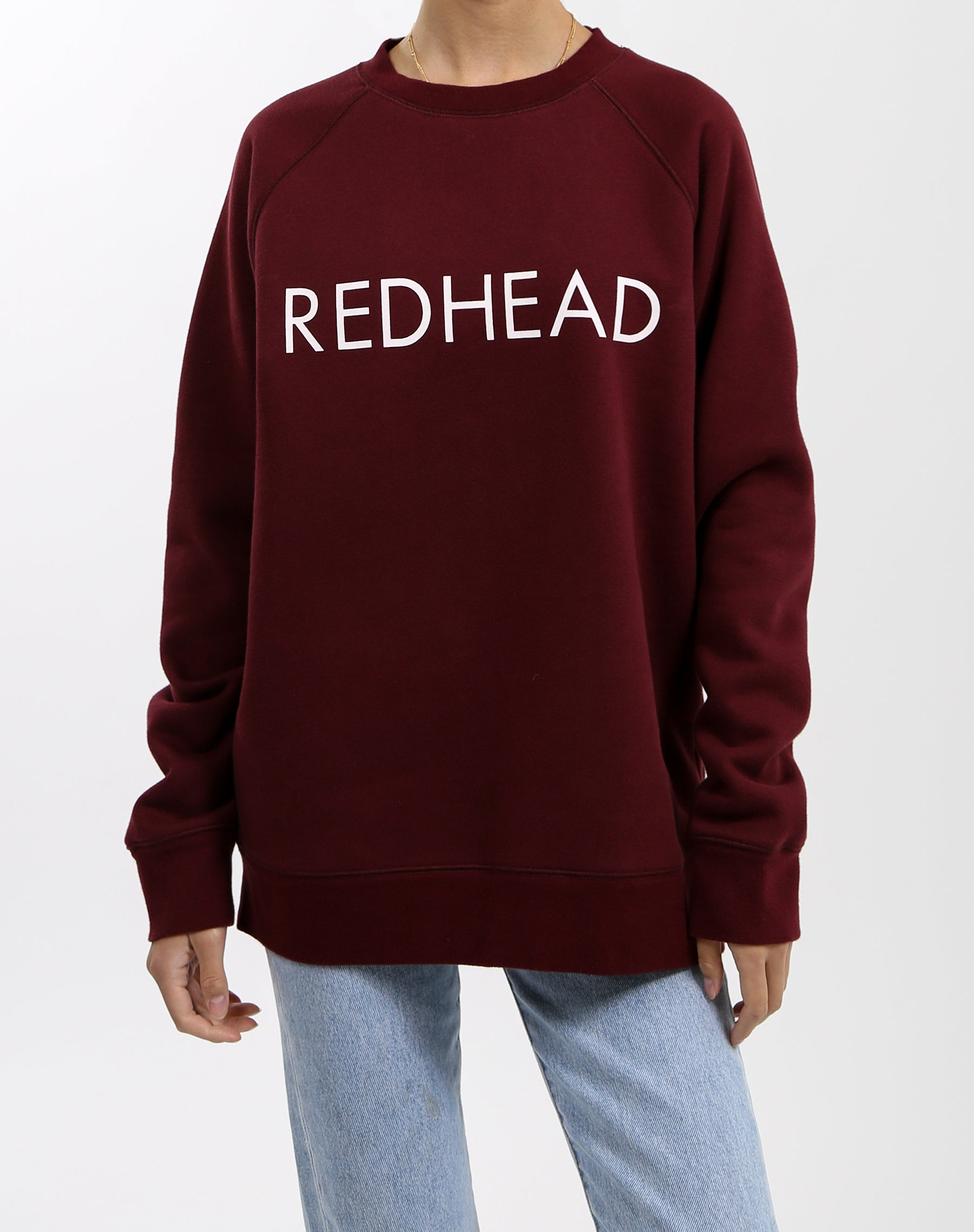 Photo of the Redhead classic crew neck sweatshirt in burgundy by Brunette the Label.