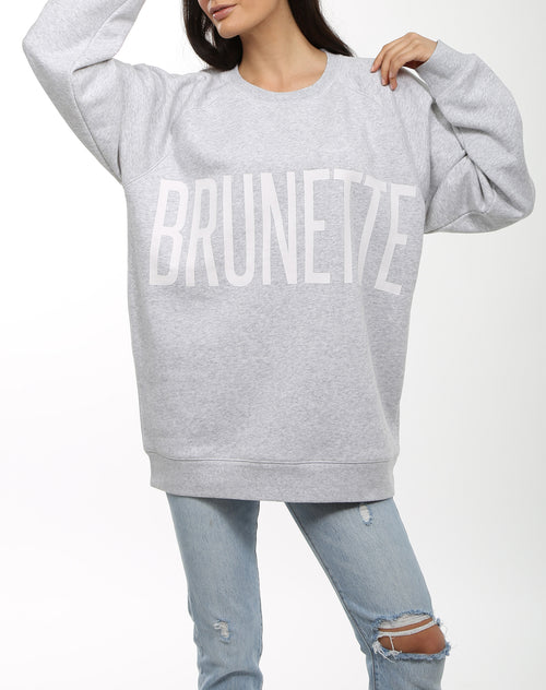 Photo of the Brunette big sister crew neck sweatshirt in pebble grey by Brunette the Label.