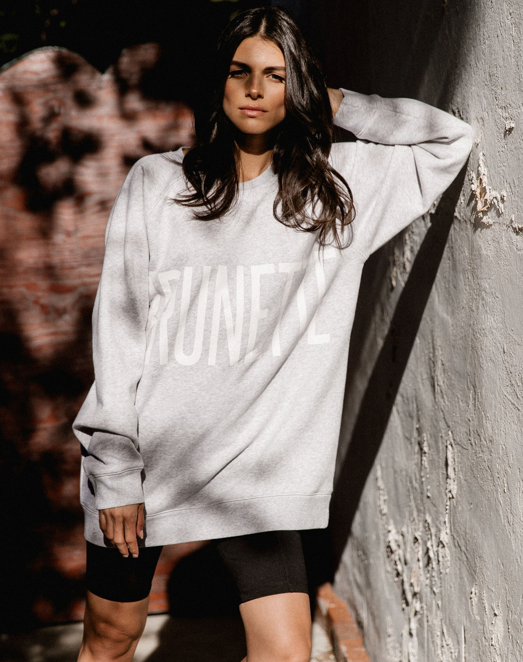 Photo 2 of the Brunette big sister crew neck sweatshirt in pebble grey by Brunette the Label.