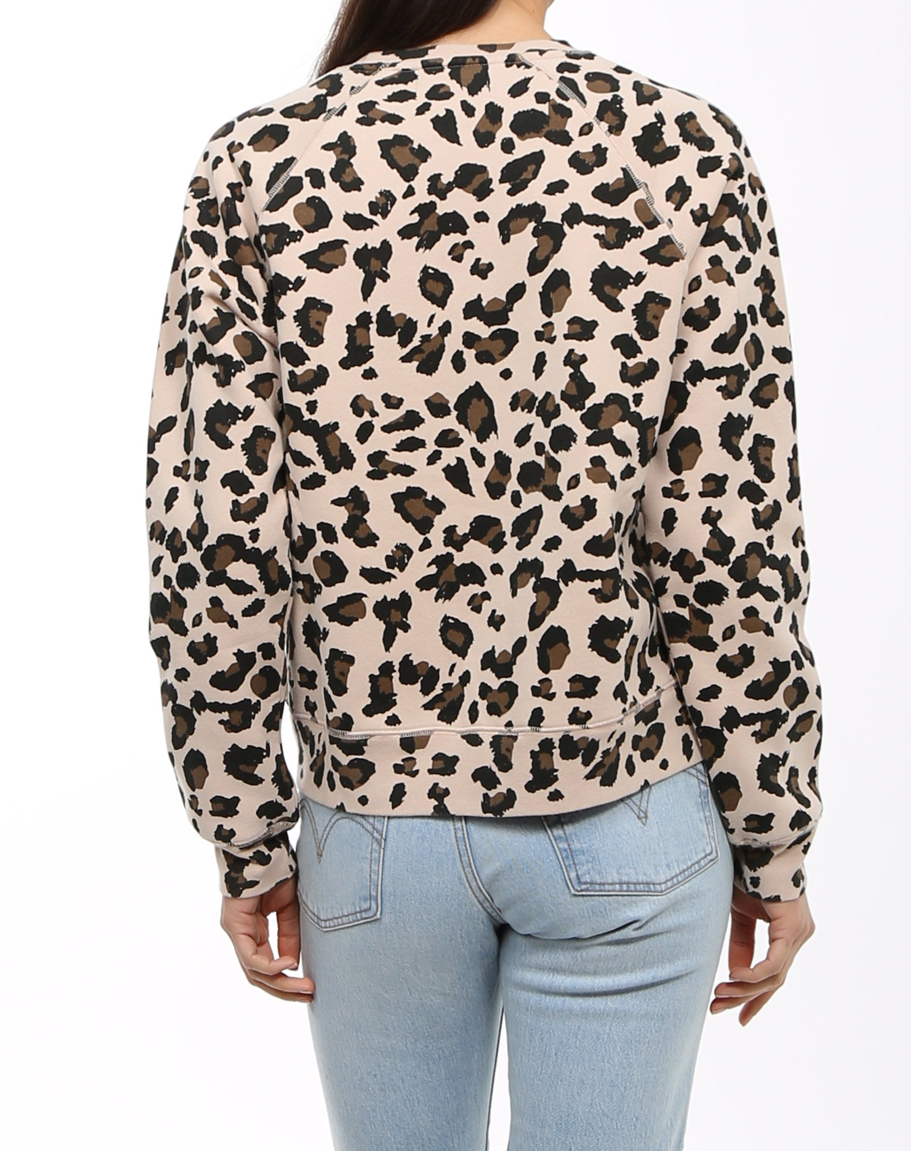 Photo of the back of the Brunette middle sister crew neck sweatshirt in leopard print by Brunette the Label.