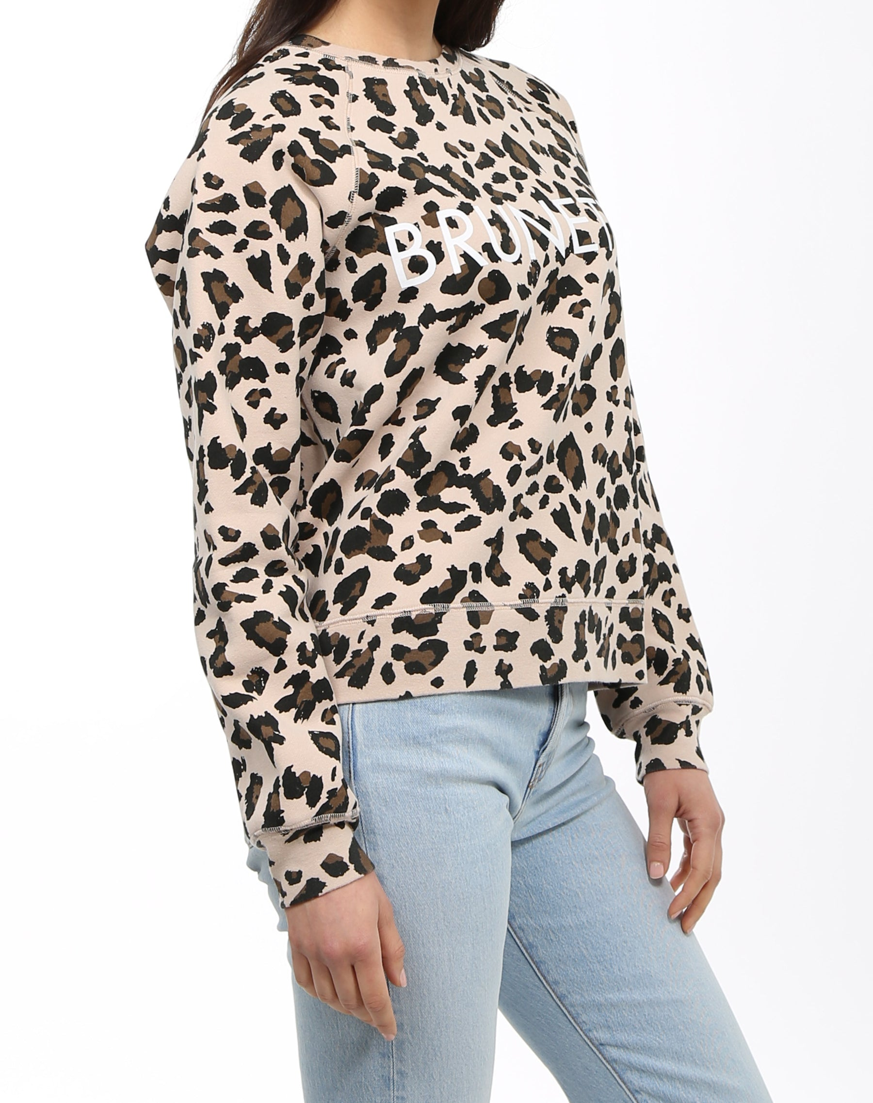Side photo of the Brunette middle sister crew neck sweatshirt in leopard print by Brunette the Label.