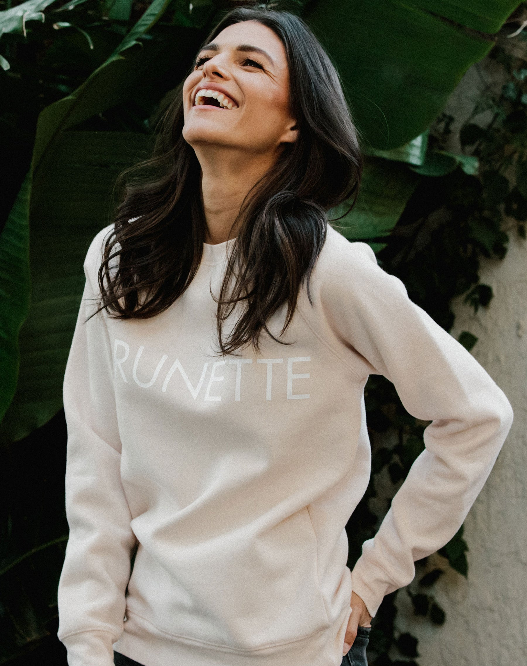 Photo of the Brunette classic crew neck sweatshirt in peach crush by Brunette the Label.
