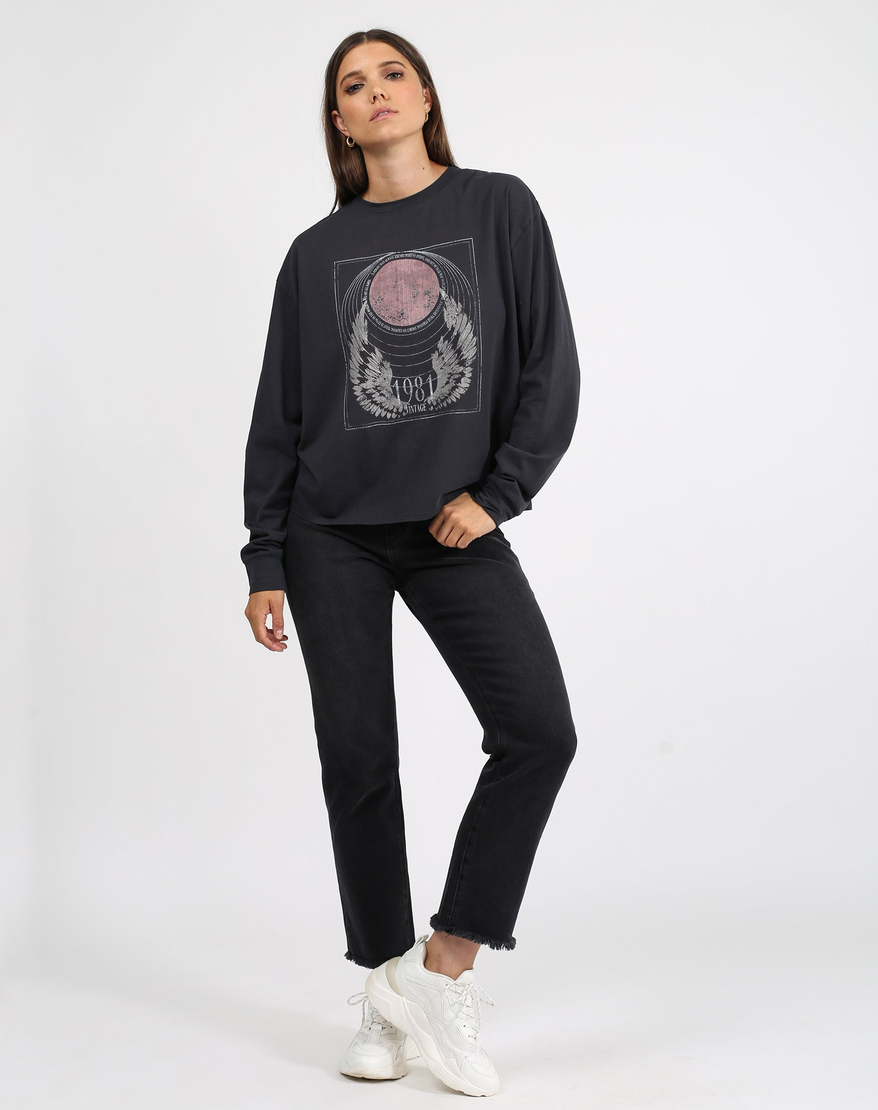 This is a photo of a model wearing the 1981 mystic long sleeve boxy tee crew neck in charcoal by brunette the label.