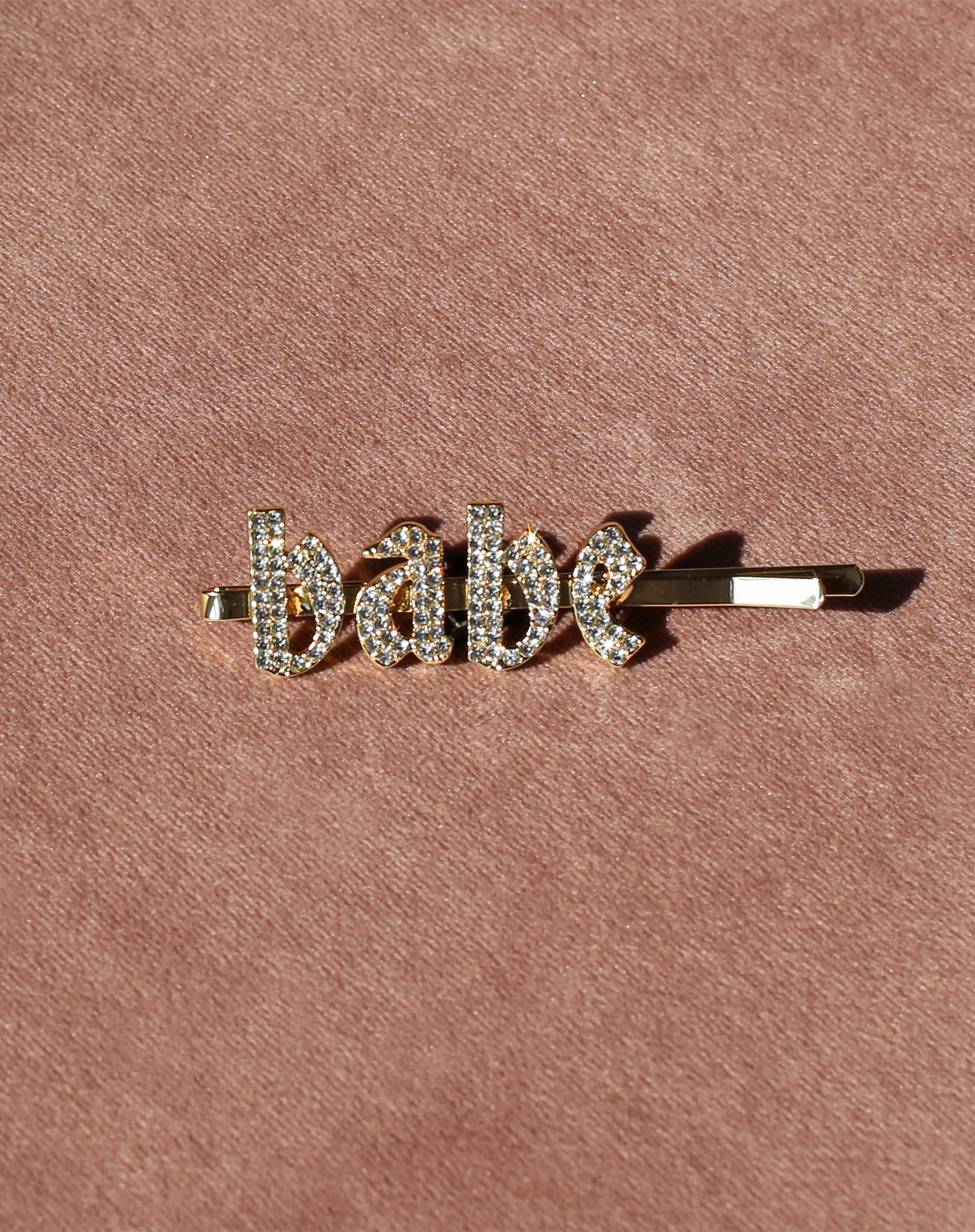 This is a photo of the Babe Rhinestone Hair Clip in Gold by Brunette the Label.