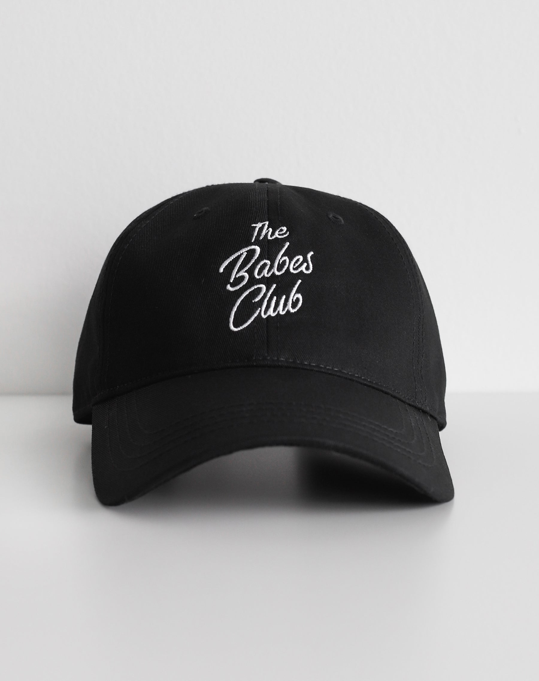 This is an image of the babes club baseball hat in black from Brunette the Label