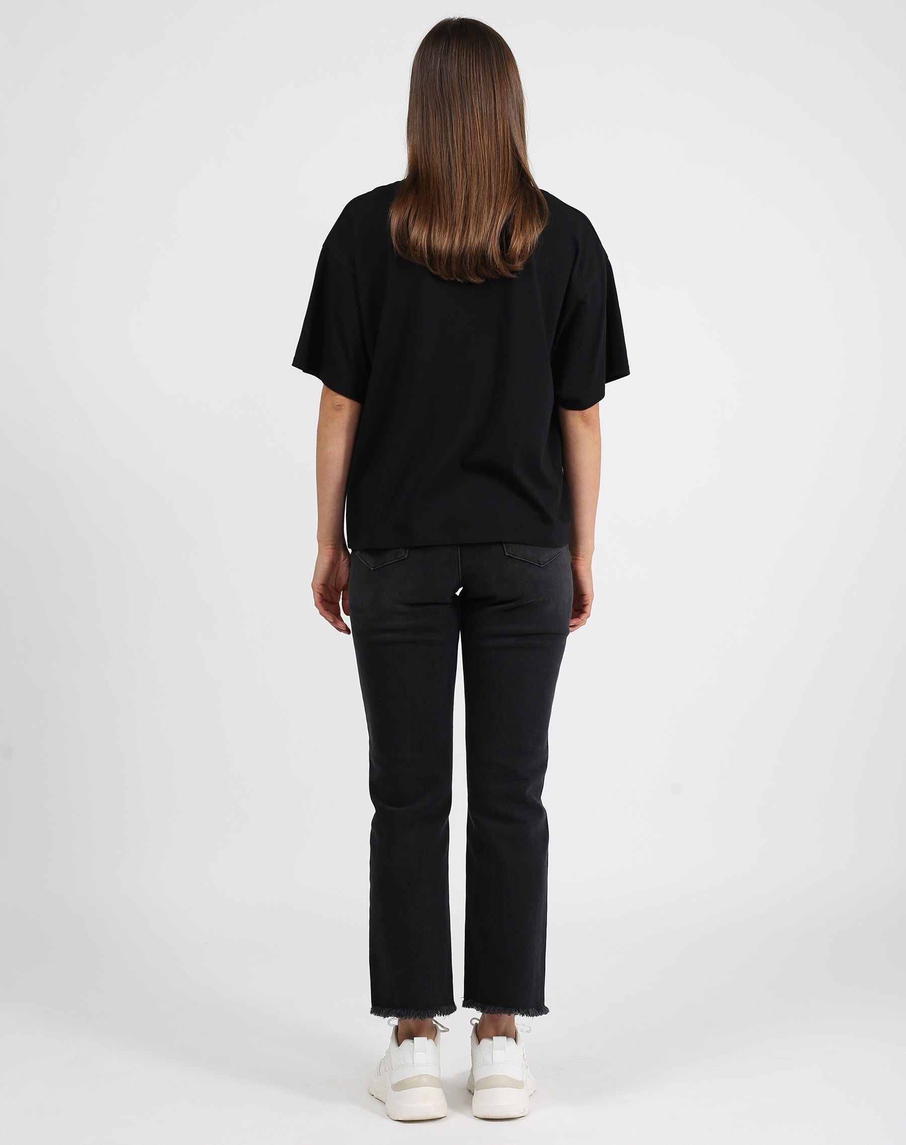 This is a photo of the back of a model wearing the babes club horse boxy crew neck tee in black by brunette the label.